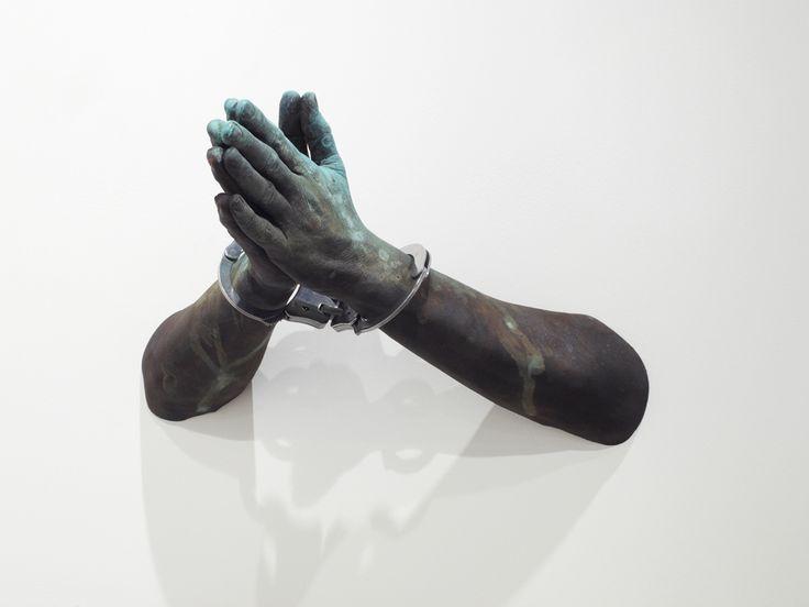 Kendell Geers - PrayPlayPreyPay (2011), bronze, handcuffs, 16 x 43 x 43 cm | kendellgeers.com