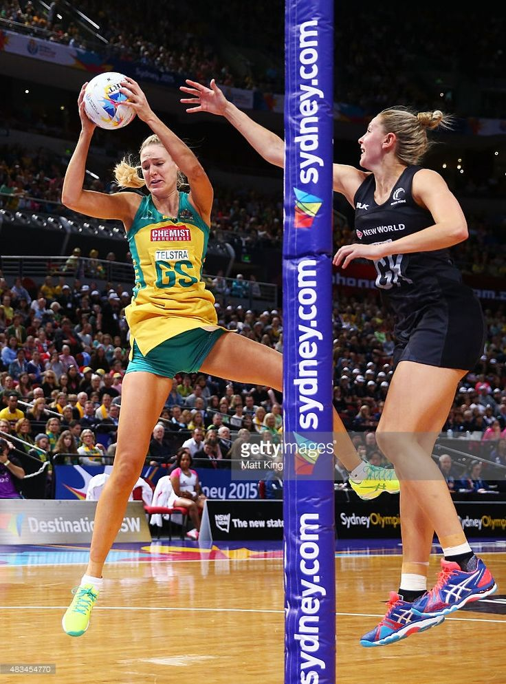 Caitlin Bassett of the Diamonds catches the ball in front of Casey Kopua of New Zealand during the 2015 Netball World Cup match between Australia and New Zealand at Allphones Arena on August 9, 2015 in Sydney, Australia.