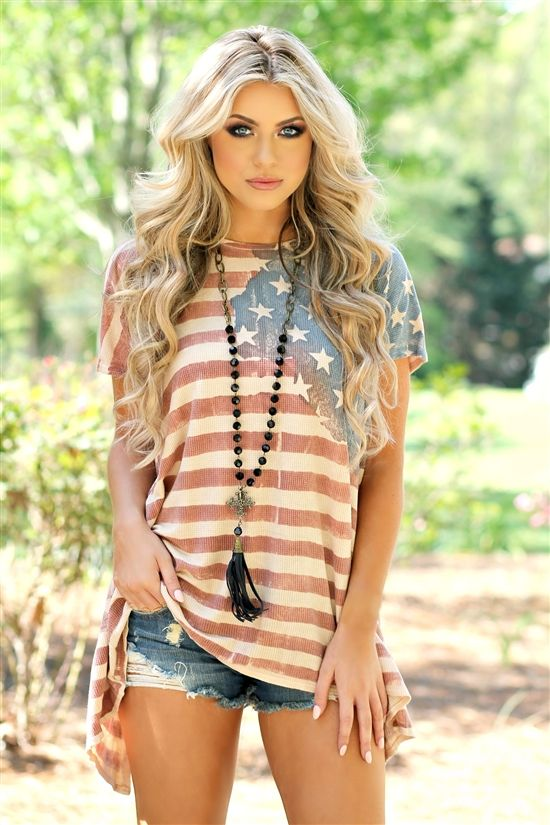 Get patriotic ready in our Star Spangled Summer Top! It's a short sleeve waffle knit top with american flag that fades. Washed out look and back splits at the bottom going up. Made to be loose fitted. Made in the USA.