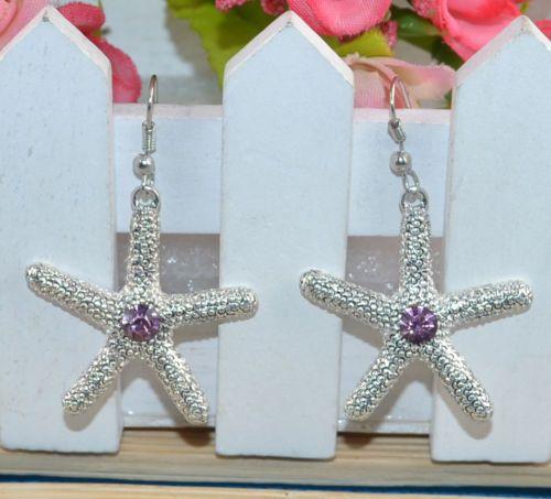 $10.000- Aretes Estrella de Mar en Plata y una Piedra color lila tamaño 3 cm Romanticos