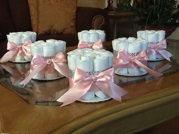 Diaper cake centerpieces could put pink flowers on top w