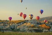 Hot air ballooning is one of the most unique and popular attractions in Cappadocia (Turkey). Experience the magic of a balloon flight and let the world below drift away. Feel the exhilaration of morning-fresh country air.  Imagine floating as gently as a cloud above the glorious vistas of beautiful valleys in Cappadocia!