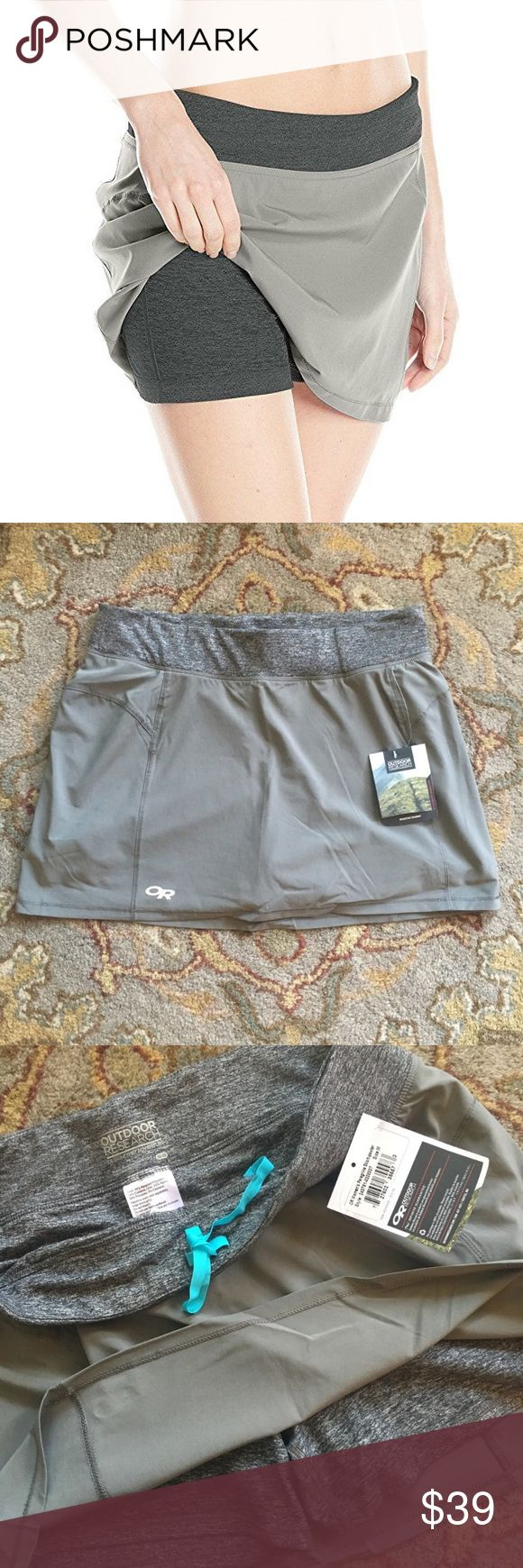 *NWT* Outdoor Research Women's Peregrine Skort, M This Outdoor Research Skort pulls no punches when upping the speed on the single-track. Built with a comfortable, supportive stretch inner short and a breathable stretch outer, the Peregrine brings a touch of feminine mystique to your latest trail race. A small zippered center-back waistband pocket securely holds keys and ID cards, and a small stealth stash pocket provides room for gel packets and energy blocks. Color is Pewter. Outdoor…