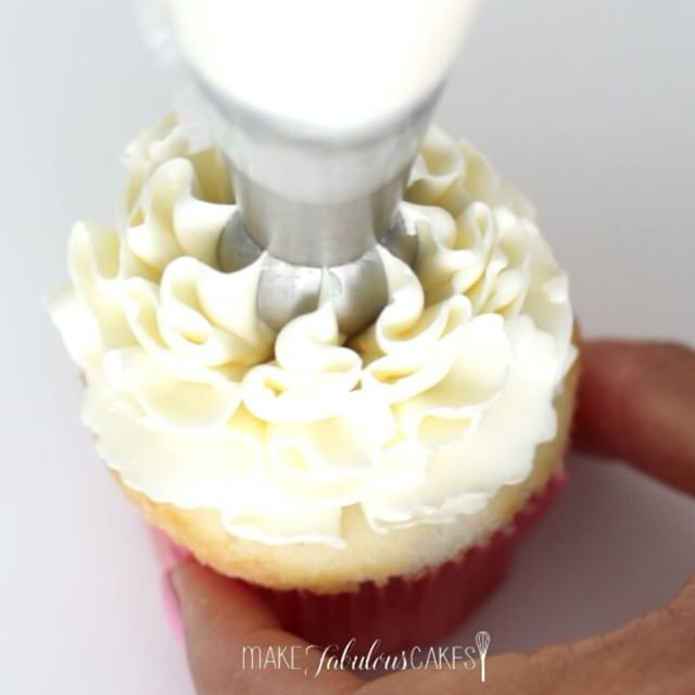 Ruffle tip in action!  It helps to twist it ever so slightly from side to side to help anchor the ruffles. It creates a hole in the middle where the tip was but it can be filled with buttercream, jam or in this case lemon curd.   Update: Since posting this video, so many of you are asking where to get this tip.  A lot of cake decorating supply stores actually carries them, they go by the name of Russian bulbous tip or sphere ball tip.  You can also get them on ebay and Amazon. ☺…