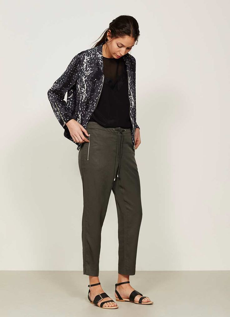 Embrace the art of effortless dressing in these dark khaki lyocell relaxed trousers. Inspired by the sports trend with a tie at the front waist, an elasticated back and zipped pockets for a chic edge. Model is 5