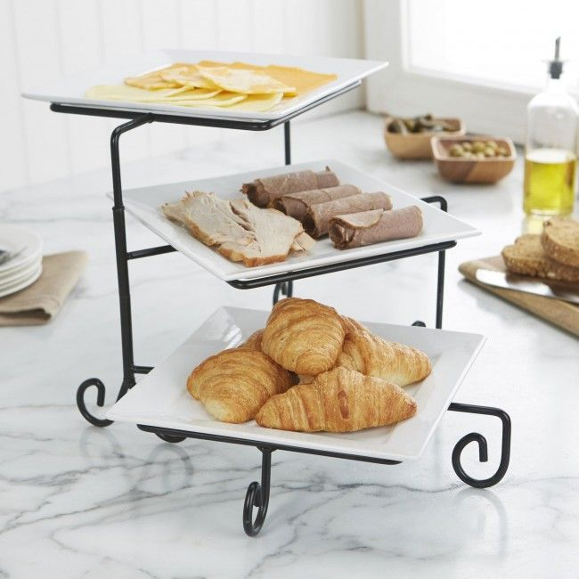 Our Aurora 3-Tier Buffet Plate is the perfect way to present and serve your favourite appetizers, hors d'oeuvres, cheese or desserts. The three tier stand swivels out for an attractive presentation and easy access to each tier. The white porcelain plates are a simple and elegant canvas to display your delicious offerings.