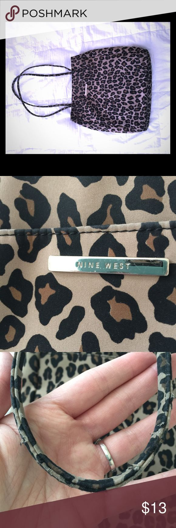 Nine West Animal Print Shoulder Bag This well-loved Nine West shoulder bag is in good used condition. All wear issues have been photographed, but purse is solid and has years of use left. Very light weight microfiber with magnetic closure and long shoulder straps. Interior is split into two sections, as pictured. Nine West Bags Shoulder Bags