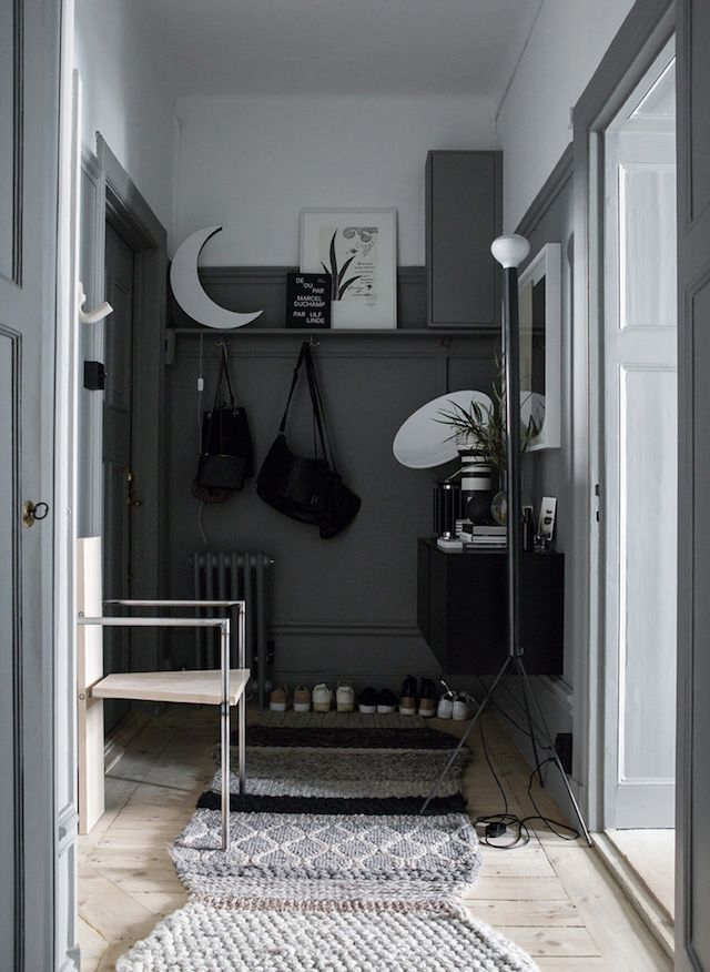 White and dark grey hallway in the atmospheric home of Swedish interior designer Lotta Agaton.