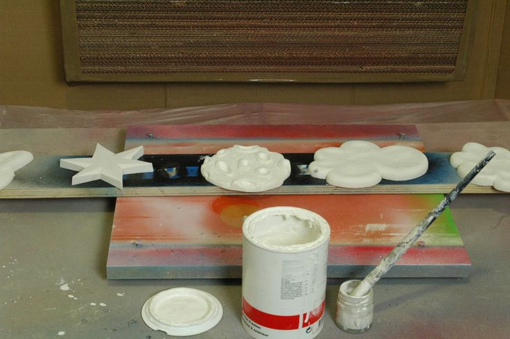 The planets and clouds have been sanded, now its time to prime them up for finishing...