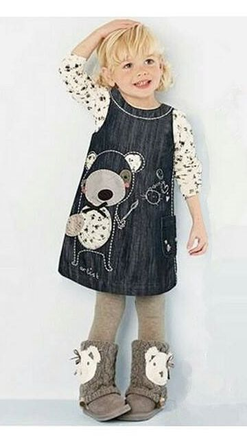 GORGEOUS DENIM STYLE DRESS!   THIS DRESS IS GREAT FOR THE AUTUMN AND WINTER MONTHS AS YOU CAN ADD LONG SLEEVED TOP AND TIGHTS TO THIS DRESS. THREE BUTTONS UP BACK AND ONE SIDE POCKET.   CUTE LITTLE TEDDY BEAR EMBROIDERED WITH PATCHWORK ON FRONT OF DRESS WITH AN EMBROIDERED OUTLINE OF TEDDY'S BACK ON REAR OF DRESS.