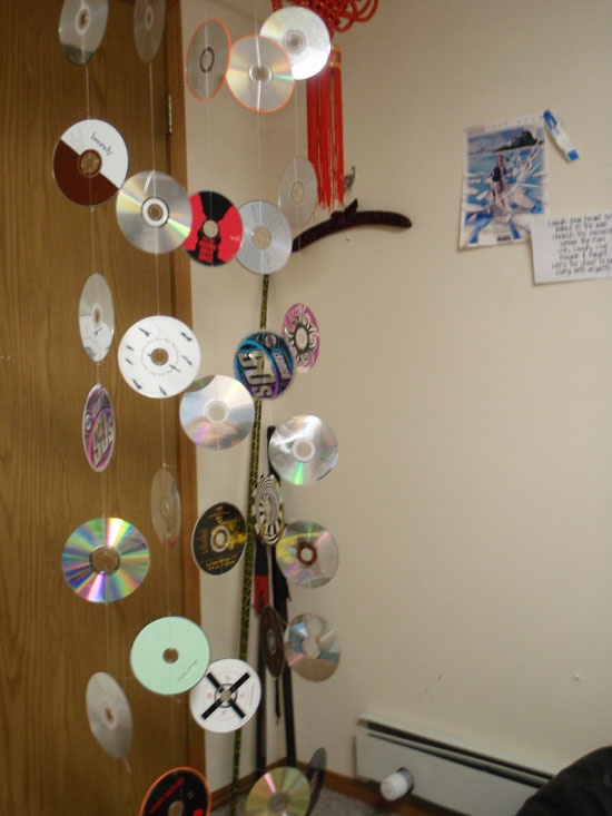 cd's on fishing line for party streamers or decorations. don't use just ordinary invitations!! have your #kids use #invitebandz for this fun-filled #party! #rocknroll #decorations