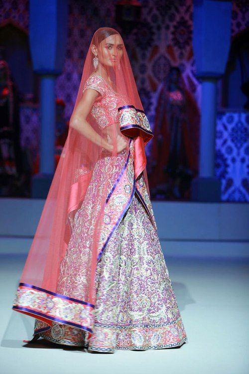 South Asian bridal lehenga. Sheer Veil overlay idea
