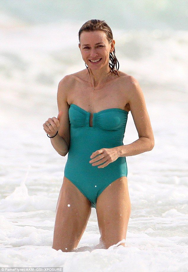 Age defying physique: Naomi Watts, 48 saw the old year out in style as as she enjoyed a vacation with her family and friends in Mexico. The actress rocked a turquoise strapless swimsuit as she waded in the ocean on Cancun beach on Sunday