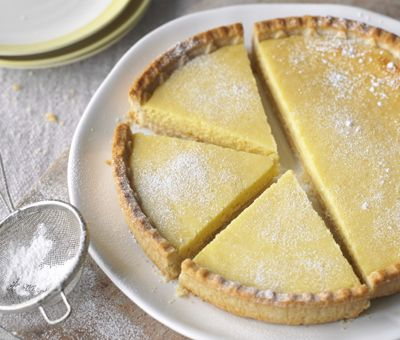 Light Lemon Tart - 4 ingredients and no fuss. A creamy, zesty, sharp and gorgeous Lemon Tart -plus 30% less fat than a normal recipe! You can make it too! Click for the recipe »