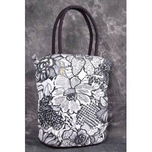 remium Quality Cotton Canvas handbags. This article has been explicitly designed with Black and White floral prints for an attractive and trendy look. Quality material and zip closure makes the bag highly functional. This spacious bag has sturdy handle that perfectly match the unique style and perfect for a day out.