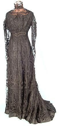 c. 1909 Black Dinner or Reception Gown of Black Dotted Net Elaborately Decorated with Braid and Satin Rouleau