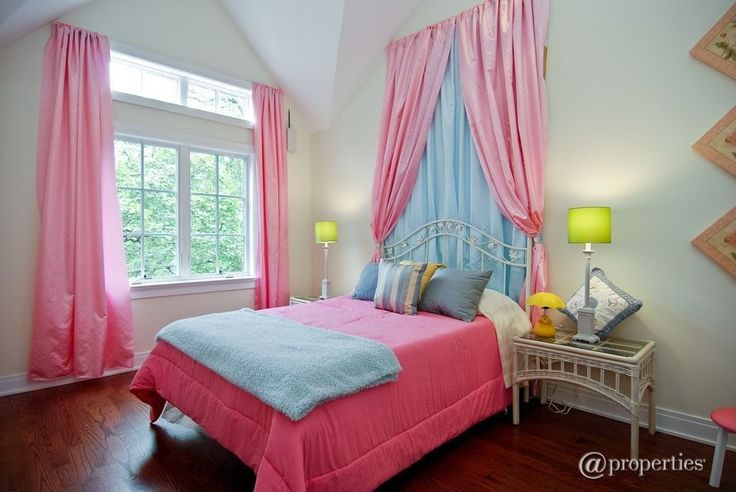 Traditional Kids Bedroom with High ceiling, Transom window, Hardwood floors, Wicker nightstand