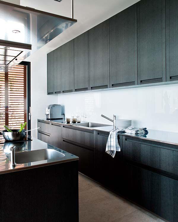 Gorgeous almost seamless Masculine kitchen.  Villa-Mallorca by Estudio Dai 10 Architect &   Interior Design.