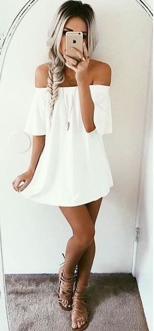 this white off the shoulder dress is so cute for the summer or spring break!