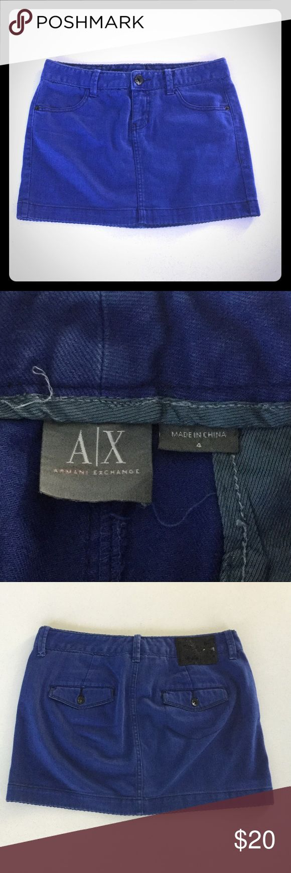 ARMANI EXCHANGE blue mini with sequin detail SZ 4 AX ARMANI EXCHANGE royal blue denim mini with black sequin detail on the back.  Cute pockets with black luxe buttons.  Size 4.  In great used condition, a bit of wear but NO flaws, stains, rips, etc. A/X Armani Exchange Skirts