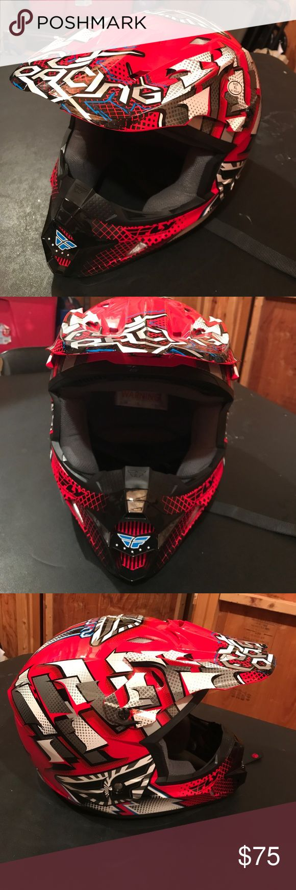 Brand New ATV Helmet Brand New ATV Helmet.  Never worn, comes with dust cloth bag. Colors red, blue, black, white and silver. Other