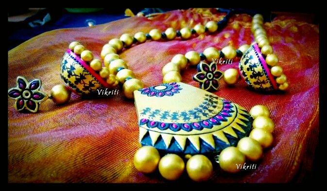 Terracotta jewellery set with handpainted warli pattern