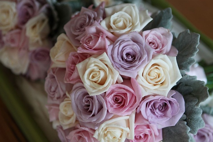Mauve, pink & ivory roses, with silver suede foliage #weddings  http://www.RedEarthFlowers.com.au/
