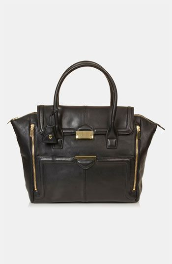 love this winged black handbag, reminiscent of the amazing bags by celine at a much more affordable price tag.