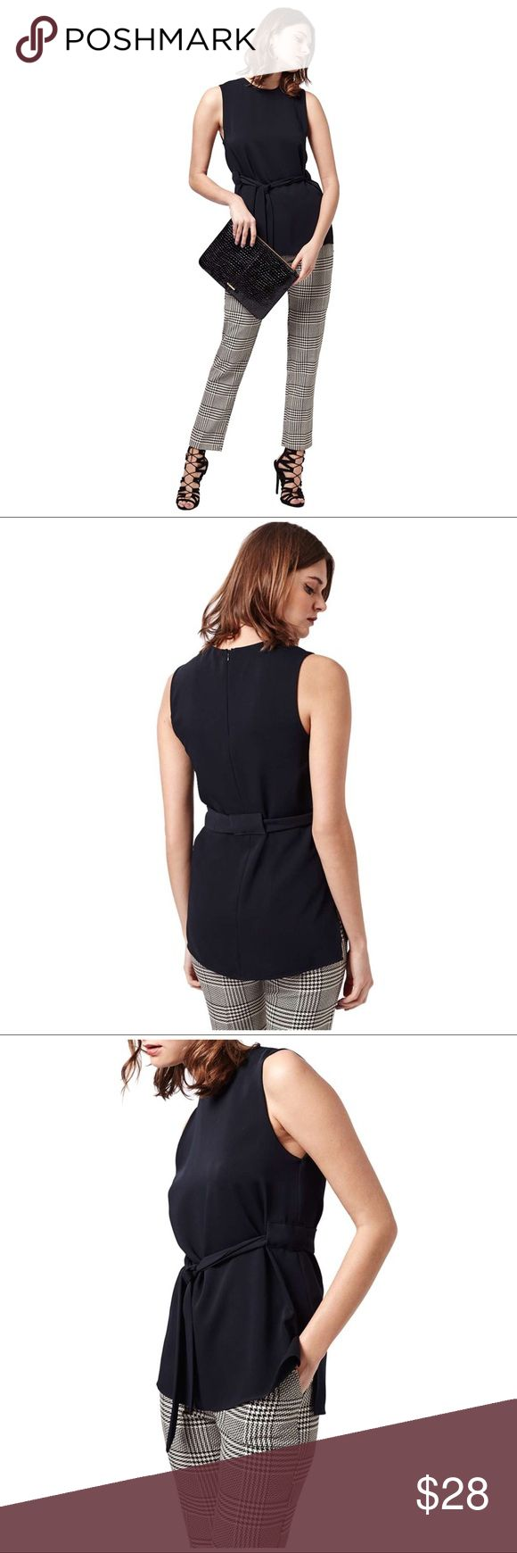 """TOPSHOP NAVY SLEEVELESS TUNIC TOP TOPSHOP SLEEVELESS TUNIC TOP ~ A figure-flattering look for a sleeveless high/low tunic top in smooth crepe (missing belt). Add your own style by using your own belt or none at all ~ Back Zip Closure ~ Length: Front 25""""/Back 28"""" Bust: 19"""" #0598 🚫Trades or Holds ✅Use offer option Topshop Tops Tunics"""