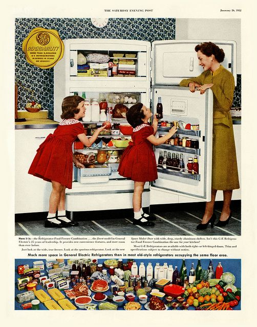A stuffed-to-capacity fridge for this lovely 1950s mom and her family.