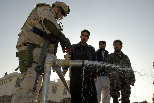 100 Images From Afghanistan - Day 20. Sergeant Donald Lees from the PRT engineer team checks the water circulation in one of the wells.  A PRT team consisting of engineers and Force Protection personnel travels onboard a Nyala RG-31 to the Kandahar university site to check the condition of the water wells.
