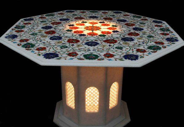 Surrealz genuine marble pietra dura table with hand carved filigree detail. Inlaid with semi precious stones - lapis lazuli, turquoise, mother of pearl With marble filigree carved pedestal base