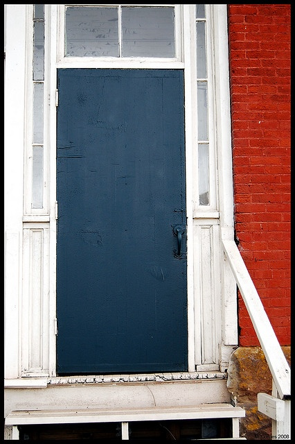 red brick blue door by matt cordes via flickr