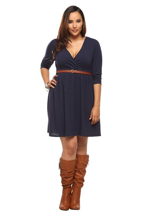 This oh-so-soft, sweater-knit dress features a surplice neckline and ruched 3/4 sleeves. A trend-right combination of the winter staple and the sexy surplice dress. Includes brown skinny belt.