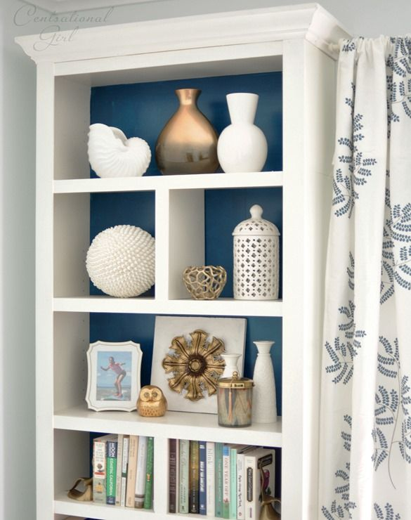modified IKEA Billy bookcase with extra trim, shelf dividers, and crown molding
