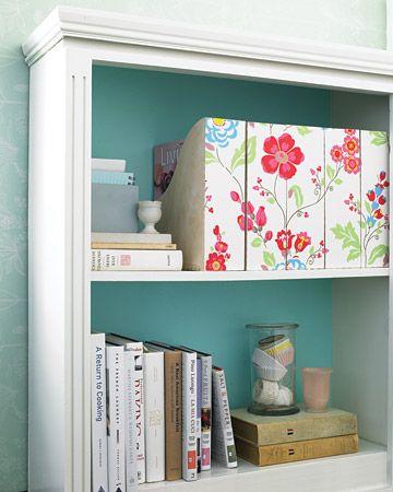 wallpaper-backed magazine holders.