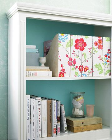Wallpapered Magazine Holder  Swap the utilitarian look and feel of magazine organizers for something more artful using inexpensive patterned wallpaper.