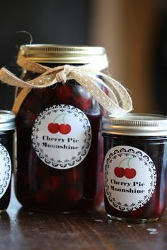 How to make Crock Pot Cherry Pie Moonshine Recipe! This homemade recipe is perfect for holiday gifts, mason jars, and as a fun mixer for cocktails! So easy to make and tastes so good!