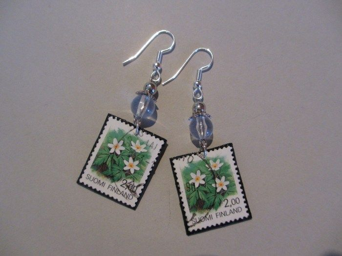 Earrings made of stamps and pearls. Minka / www.madeby.fi