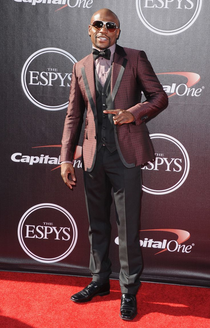 Boxer Floyd Mayweather Jr arrives at the 2014 ESPYS at Nokia Theatre L.A. Live in LA is seen wearing an intricate 3-piece suit. via StyleList | http://aol.it/1zMyLuI
