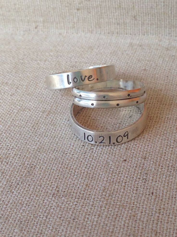 Sterling silver stack rings personalized by CommittedJewelry with Jonah's name and his birthday.