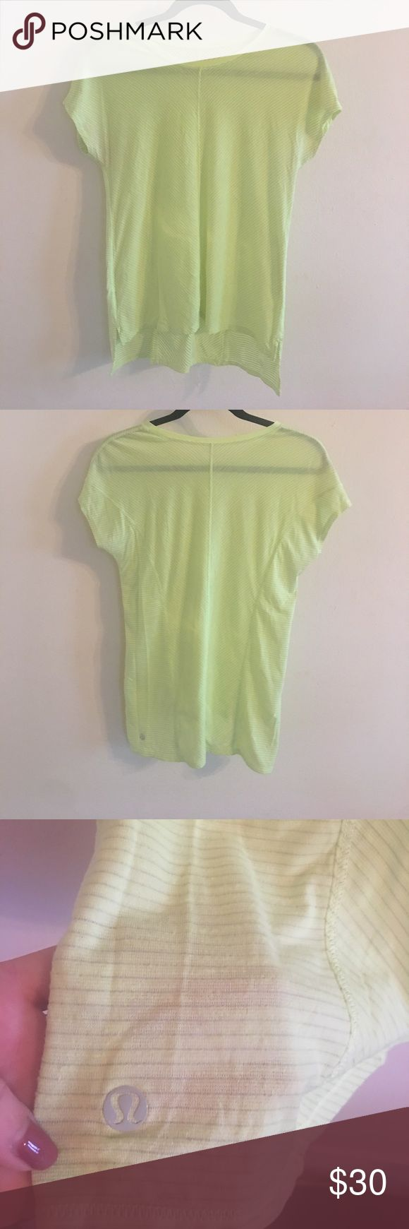 Lululemon neon yellow top Bright yellow lululemon shirt sleeve shirt. Super light and great for running or at the gym. More of a high low fit- shorts in the front and longer in the back. Open to offers but please no low balls! lululemon athletica Tops Tees - Short Sleeve
