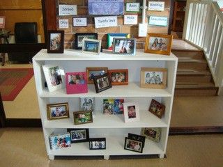 Kids bring in a picture frame of their families and the classroom is decorated with them!  How sweet to connect home and school!