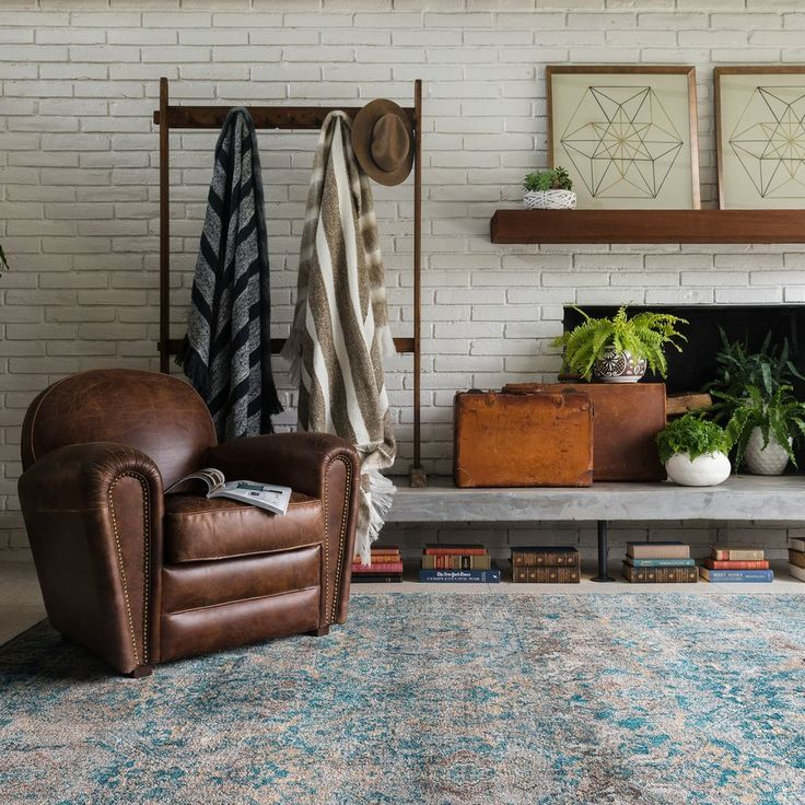 Color story:  deep rich brown, washed out white, cognac wood accents, antique blues + turquoise layered with a slew of warm neutrals and of course -- plant life