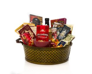 """Take A Break"" Basket  A Woven Basket containing Yummy Treats for any Break Time... Coffee, Chai Tea, Gourmet Flavoured Hot Chocolates, Coffee Toppers, Fudge, Cookies, Chocolates and a nice Coffee Mug.    A Perfect Gift for Anyone  $60.00 CAD"