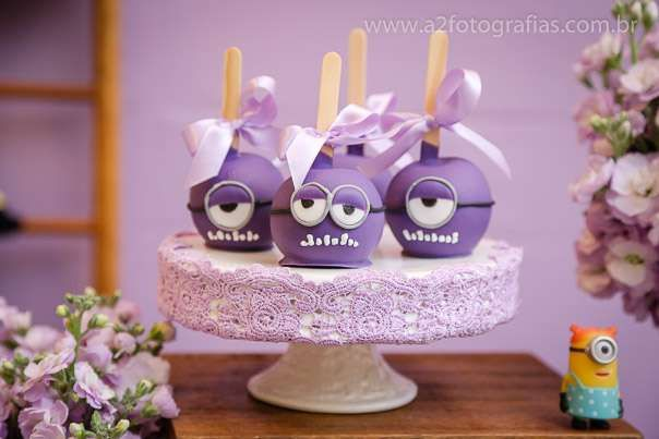 Purple candy apples at a Despicable Me Minions birthday party! See more party planning ideas at CatchMyParty.com!
