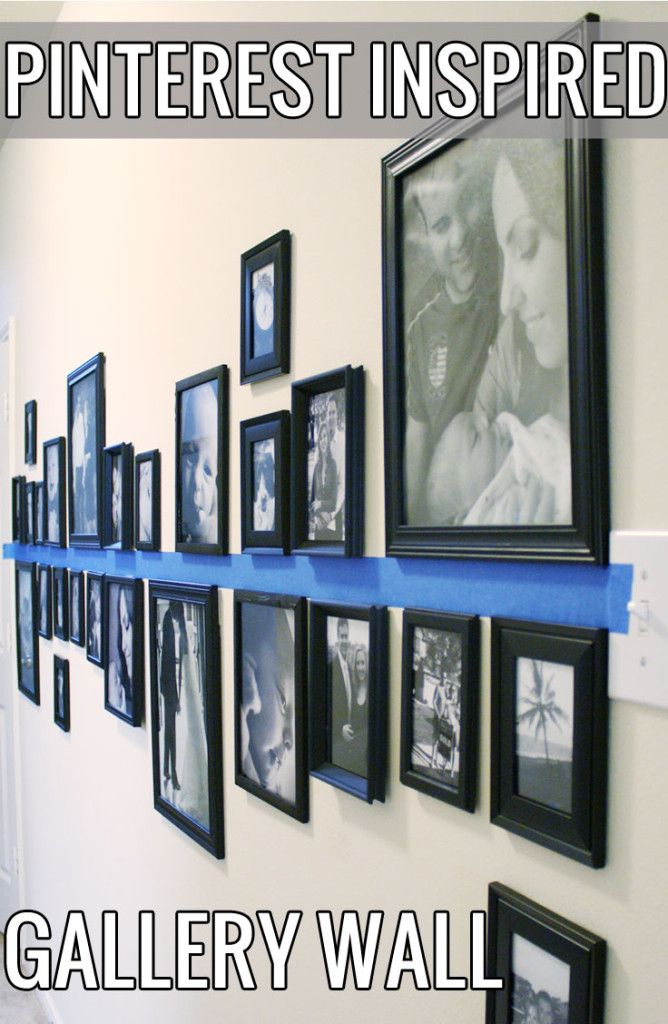 Pinterest Inspired Gallery Wall - super easy DIY. Place painter's tape across a wall, hang pictures in various sizes above/below the space. Hang with command strips to avoid wall damage.
