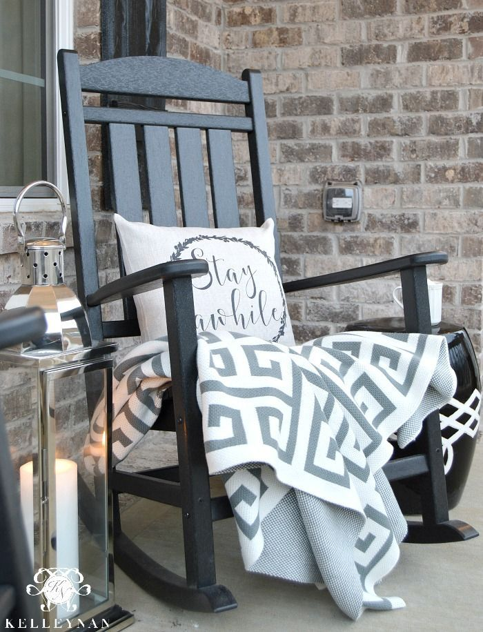 Delightful Black Rocking Chair On Front Porch With Lantern