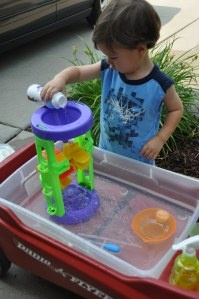 homemade water table - definitely plan to rig up something fun for Eli next summer! Could easily make this a little more fun using old cups or apple juice bottle (put hole in bottom and mount it), add some bright colors toys from the dollar tree and I have a feeling this will be lots of fun in the years to come!
