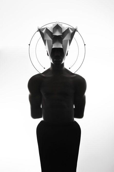 Origami headgear folded to resemble mythological creatures